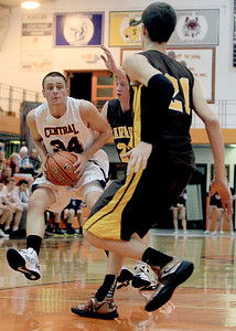 Sarah Nader - snader@shawmedia.com Crystal Lake Central's Jake VanScoyoc takes a shot during Monday's Coaches Vs. Cancer Thanksgiving Tournament against Hoffman Estates at Crystal Lake Central on November 19, 2012. McHenry was defeated, 52-62.