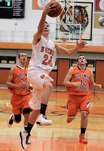 Sarah Nader - snader@shawmedia.com McHenry's Alec Byers takes a shot during Monday's Coaches Vs. Cancer Thanksgiving Tournament against Hoffman Estates at Crystal Lake Central on November 19, 2012. McHenry was defeated, 52-62.