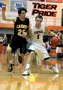 Sarah Nader - snader@shawmedia.com Crystal Lake Central's Corban Murphy (right) is guarded by Carmel's Greg Edkins during Monday's Coaches Vs. Cancer Thanksgiving Tournament at Crystal Lake Central on November 19, 2012. McHenry was defeated, 52-62.