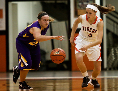 Josh Peckler - Jpeckler@shawmedia.com Crystal Lake Central's Evelyn Youel (3) and Wauconda's Becca Michelau go after a loose ball during the second quarter at Crystal Lake Central High School Monday, November 12, 2012. Crystal Lake Central defeated the visiting Lady Bulldogs 44-28.