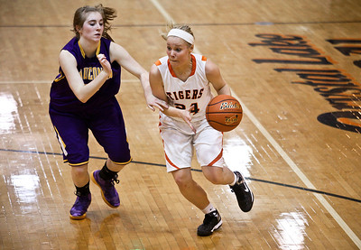 Josh Peckler - Jpeckler@shawmedia.com Crystal Lake Central's Kristen Bernero drives the ball past Wauconda's   Jess Wood during the fourth quarter at Crystal Lake Central High School Monday, November 12, 2012. Crystal Lake Central defeated the visiting Lady Bulldogs 44-28.