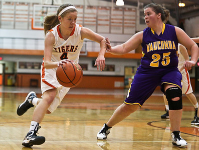 Josh Peckler - Jpeckler@shawmedia.com Crystal Lake Central's Katie Mcguire drives the ball to the basket while being guarded by Wauconda's Maggie LePage during the third quarter at Crystal Lake Central High School Monday, November 12, 2012. Crystal Lake Central defeated the visiting Lady Bulldogs 44-28.