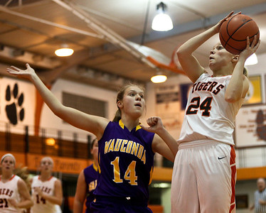 Josh Peckler - Jpeckler@shawmedia.com Crystal Lake Central's Kristen Bernero goes up for a lay up in front of  Wauconda's Kelly Haberichter during the fourth quarter at Crystal Lake Central High School Monday, November 12, 2012. Crystal Lake Central defeated the visiting Lady Bulldogs 44-28.