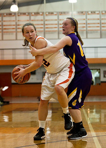 Josh Peckler - Jpeckler@shawmedia.com Crystal Lake Central's Claire Dalman is guarded by Wauconda's Lauren Nee during the fourth quarter at Crystal Lake Central High School Monday, November 12, 2012. Crystal Lake Central defeated the visiting Lady Bulldogs 44-28.
