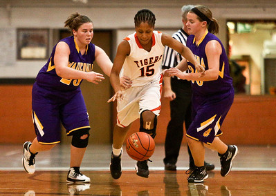 Josh Peckler - Jpeckler@shawmedia.com Crystal Lake Central's Paige Celestin-Dowell (15) dribbles the ball in between Wauconda's Becca Michelau (left) and Jena Heck during the second quarter at Crystal Lake Central High School Monday, November 12, 2012. Crystal Lake Central defeated the visiting Lady Bulldogs 44-28.