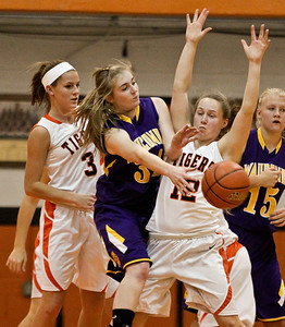Josh Peckler - Jpeckler@shawmedia.com Wauconda's Jessie Wood (34) tries to get a pass off while being guarded by Crystal Lake Central's Evelyn Youel (3) and Claire Dalman during the first quarter at Crystal Lake Central High School Monday, November 12, 2012. Crystal Lake Central defeated the visiting Lady Bulldogs 44-28.