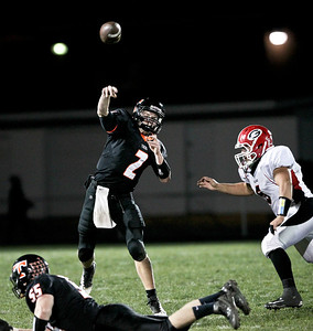 Josh Peckler - Jpeckler@shawmedia.com Crystal Lake Central quarterback Kyle Lavand throws a pass against Grant during the third quarter at Crystal Lake Central Friday, November 2, 2012. The Tigers defeated visiting Grant 30-13 to move on to the third round playoff game.