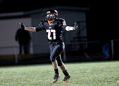 Josh Peckler - Jpeckler@shawmedia.com Crystal Lake Central's Kevin Peisker celebrates a Tiger touchdown against Grant in the second quarter at Crystal Lake Central Friday, November 2, 2012. The Tigers defeated visiting Grant 30-13 to move on to the third round playoff game.