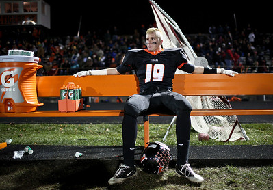 Josh Peckler - Jpeckler@shawmedia.com Crystal Lake Central's Luke Francis takes a break on a bench as he watches the offense on the field during the fourth quarter at Crystal Lake Central Friday, November 2, 2012. The Tigers defeated visiting Grant to move on to the third round playoff game.