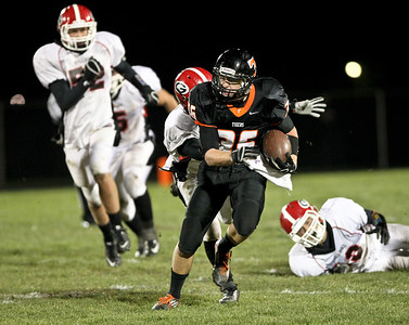 Josh Peckler - Jpeckler@shawmedia.com Crystal Lake Central's Tyler Jenkins runs away from the Grant defense during the fourth quarter at Crystal Lake Central Friday, November 2, 2012. The Tigers defeated visiting Grant 30-13 to move on to the third round playoff game.