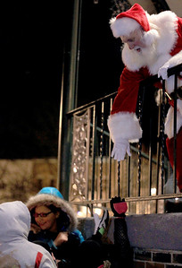 Sarah Nader - snader@shawmedia.com Santa greets children on the Woodstock Square after the Lighting of the Square in Woodstock on Friday, November 23, 2012. The event brings out a crowd of nearly 2,000 every year.