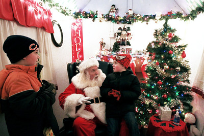 Sarah Nader - snader@shawmedia.com Dominick Faillow (left), 9, of Marengo and his cousin Anthony Faillow, 7, talk to Santa on the Woodstock Square after the Lighting of the Square in Woodstock on Friday, November 23, 2012. The event brings out a crowd of nearly 2,000 every year.