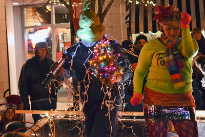 Monica Maschak - mmaschak@shawmedia.com A float member dressed as the Grinch made himself visible to the crowd wih a flashlight and flashing Christmas lights at the holiday parade in Downtown Crystal Lake on Friday, November 23, 2012.
