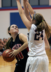 Monica Maschak - mmaschak@shawmedia.com Sam Andrews, for Huntley, looks for an opening to the net in a game against St. Viator at the Dundee-Crown Thanksgiving Tournament on Friday, November 16, 2012.  The Lady Red Raiders beat the Lady Lions 48-33.