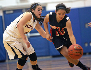 Monica Maschak - mmaschak@shawmedia.com Huntley's Kayla Barreto maneuvers the ball around her opponent in a game against St. Viator at the Dundee-Crown Thanksgiving Tournament on Friday, November 16, 2012.  Huntley beat St. Viator 48-33.