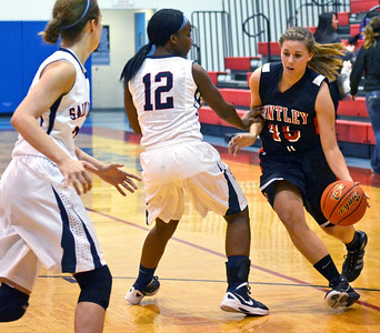 Monica Maschak - mmaschak@shawmedia.com Rachel Zobott, for Huntley, tries to dribble around the defending players in a game against St. Viator at the Dundee-Crown Thanksgiving Tournament on Friday, November 16, 2012.  The Lady Red Raiders beat the Lady Lions 48-33.
