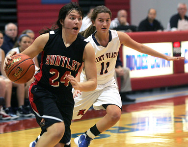 Monica Maschak - mmaschak@shawmedia.com Huntley's Bethany Zornow dribbles the ball past her opponent in a game against St. Viator at the Dundee-Crown Thanksgiving Tournament on Friday, November 16, 2012.  Huntley beat St. Viator 48-33.