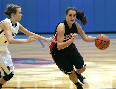 Monica Maschak - mmaschak@shawmedia.com Huntley's Haley Ream dribbles the ball past her opponent in a game against St. Viator at the Dundee-Crown Thanksgiving Tournament on Friday, November 16, 2012.  Huntley beat St. Viator 48-33.