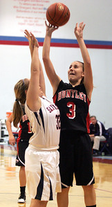 Monica Maschak - mmaschak@shawmedia.com Huntley's Amanda Kaniewski attempts a point in a game against St. Viator at the Dundee-Crown Thanksgiving Tournament on Friday, November 16, 2012.  The Lady Red Raiders beat the Lady Lions 48-33.