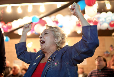 Josh Peckler - Jpeckler@shawmedia.com Becky Ruffin-Olson of Crystal Lake celebrates after learning that the Republican Party would remain control of the U.S. House of Representatives during a Republican rally party held at the McHenry County Republican headquarters in Crystal Lake Tuesday, November 6, 2012.