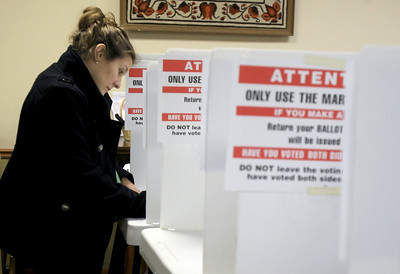 Sarah Nader - snader@shawmedia.com Ellen Garvin-Hogel of Cary casts her vote on election night at the Kraus Senior Center polling station in Cary on Tuesday, November 6, 2012.