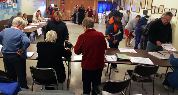 Monica Maschak - mmaschak@shawmedia.com The American Legion Hall in McHenry buzzed with voters - from precincts 3 and 21 - preparing to cast their ballots yesterday.