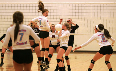 Monica Maschak - mmachak@shawmedia.com Players from the Marian Central volleyball team watch as the ball slips through a hole in their formation allowing their opponent to gain a point.  The lady hurricanes lost to the lady rockets 2-1 in Thursday's Class 3A Sectional Championship game at Marian Central Catholic High School in Woodstock.