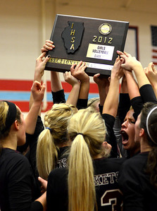 Monica Maschak - mmaschak@shawmedia.com Ladies from the Richmond-Burton volleyball team hold Class 3A Sectional Champions plaque from the Illinois High School Association over their heads after defeating their host Marian Central Catholic 2-1 Thursday, November 1, 2012.