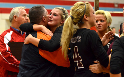 Monica Maschak - mmaschak@shawmedia.com The Richmond-Burton Lady Rockets hugged friends and family as they rushed the court after a 2-1 victory over their host, Marian Central, giving them the title of Class 3A Sectional Champions.