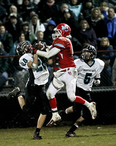 Josh Peckler - Jpeckler@shawmedia.com Woodstock North's Shane Zieman (28) and Marian's Tony Milone battle for a ball in the air while Woodstock North's Jake Schnulle (5) looks on during the second quarter at Marian Central High School Saturday, November 3, 2012. Marian Central defeated visiting Woodstock North 41-20 to advance to the quarterfinals against Montini next weekend.