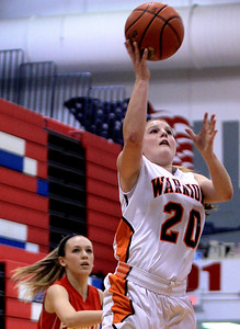 Sarah Nader - snader@shawmedia.com McHenry's Alissa Rosga takes a shot during the second quarter of Wednesday's game against Palatine at Dundee-Crown High School in Carpentersville on November 14, 2012.