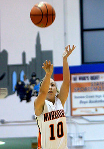 Sarah Nader - snader@shawmedia.com McHenry's Laura D'Angelo takes a shot during the second quarter of  Wednesday's game at Dundee-Crown High School in Carpentersville on November 14, 2012.