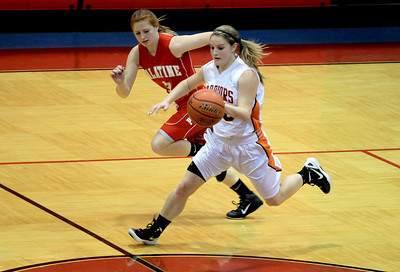 Sarah Nader - snader@shawmedia.com Palatine's Bridget Ryan guards McHenry's Alissa Rosga as she brings the ball down court during the first quarter of Wednesday's game against Palatine at Dundee-Crown High School in Carpentersville on November 14, 2012.