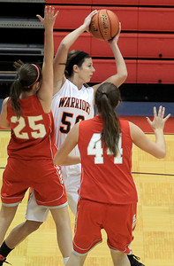 Sarah Nader - snader@shawmedia.com McHenry's Brittany Avonts (center) looks for an open player during the first quarter of Wednesday's game against Palatine at Dundee-Crown High School in Carpentersville on November 14, 2012.