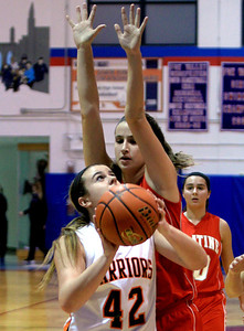 Sarah Nader - snader@shawmedia.com McHenry's McKayla Snedeker (left) takes a shot during the second quarter of Wednesday's game at Dundee-Crown High School in Carpentersville on November 14, 2012.