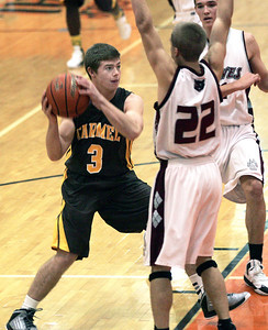 Monica Maschak - mmaschak@shawmedia.com Carmel Catholic's Mark Amick looks for an opening to shoot the ball in a game against Prairie Ridge at the Coaches vs. Cancer tournament hosted by Crystal Lake Central High School on Saturday, November 24, 2012.  The Wolves beat the Corsairs 76-71.