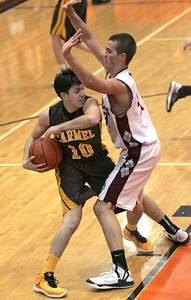 Monica Maschak - mmaschak@shawmedia.com Carmel Catholic's Nick Pullano attempts to get the ball past his opponent in a game against Prairie Ridge at the Coaches vs. Cancer tournament hosted by Crystal Lake Central High School on Saturday, November 24, 2012.  The Wolves beat the Corsairs 76-71.