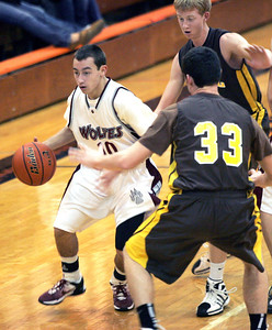 Monica Maschak - mmaschak@shawmedia.com Prairie Ridge Guard Jay DeLage dribbles toward the hoop in a game against Carmel Catholic at the Coaches vs. Cancer tournament hosted by Crystal Lake Central High School on Saturday, November 24, 2012.  The Wolves beat the Corsairs 76-71.