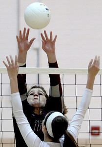Sarah Nader - snader@shawmedia.com Prairie Ridge's Maddie Drain jumps to block a ball during Thursday's Class 4A Jacobs Sectional volleyball final against Boylan in Algonquin on November 1, 2012. Prairie Ridge won, 2-1.