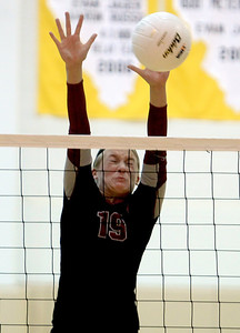 Sarah Nader - snader@shawmedia.com Prairie Ridge's Ali Witt jumps to block a ball during Thursday's Class 4A Jacobs Sectional volleyball final against Boylan in Algonquin on November 1, 2012. Prairie Ridge won, 2-1.