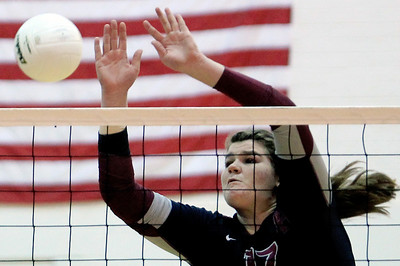 Sarah Nader - snader@shawmedia.com Prairie Ridge's Maddie Drain jumps to block the ball during Thursday's Class 4A Jacobs Sectional volleyball final against Boylan in Algonquin on November 1, 2012. Prairie Ridge won, 2-1.