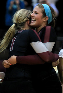Sarah Nader - snader@shawmedia.com Prairie Ridge's Mackenzie (right) Humm hugs her teammate,Caitlin Brauneis after winning Thursday's Class 4A Jacobs Sectional volleyball final against Boylan in Algonquin on November 1, 2012. Prairie Ridge won, 2-1.