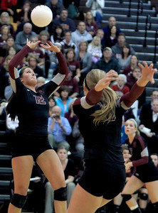Sarah Nader - snader@shawmedia.com Prairie Ridge's Mackenzie Humm sets the ball during Thursday's Class 4A Jacobs Sectional volleyball final against Boylan in Algonquin on November 1, 2012. Prairie Ridge won, 2-1.