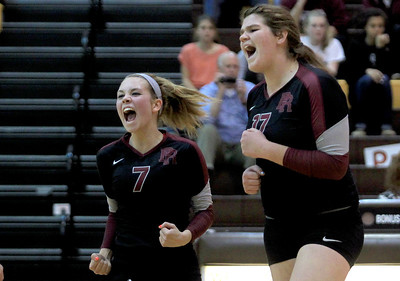 Sarah Nader - snader@shawmedia.com Prairie Ridge's Taylor Otto (left) and Maddie Drain celebrate a point   during Thursday's Class 4A Jacobs Sectional volleyball final against Boylan in Algonquin on November 1, 2012. Prairie Ridge won, 2-1.