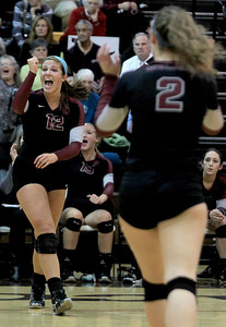 Sarah Nader - snader@shawmedia.com Prairie Ridge's Mackenzie Humm (left) celebrates a point during Thursday's Class 4A Jacobs Sectional volleyball final against Boylan in Algonquin on November 1, 2012. Prairie Ridge won, 2-1.