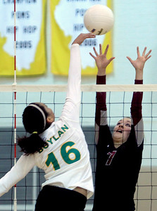 Sarah Nader - snader@shawmedia.com Prairie Ridge's Taylor Otto jumps to block a ball during Thursday's Class 4A Jacobs Sectional volleyball final against Boylan in Algonquin on November 1, 2012. Prairie Ridge won, 2-1.