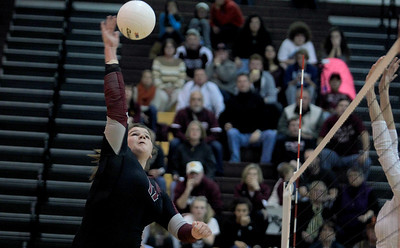 Sarah Nader - snader@shawmedia.com Prairie Ridge's Maddie Drain hits the ball over during Thursday's Class 4A Jacobs Sectional volleyball final against Boylan in Algonquin on November 1, 2012. Prairie Ridge won, 2-1.