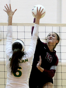 Sarah Nader - snader@shawmedia.com Boylan's Bridget Guinane (left) jumps to block the ball hit by Prairie Ridge's Ali Witt during Thursday's Class 4A Jacobs Sectional volleyball final in Algonquin on November 1, 2012. Prairie Ridge won, 2-1.