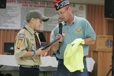 Monica Maschak - mmaschak@shawmedia.com Fifth grader Presley Diakow, 10 (left), accepts a plaque and t-shirt from VFW Post 4600 commander Ronnie Reber after collecting donations of 73 turkeys and 24 hams for the Great Lakes sailors who spent their Thanksgiving at the McHenry VFW.