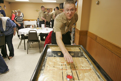 Monica Maschak - mmaschak@shawmedia.com Navy Engineman Fireman Recruit Keenan Kotanen plays an arcade game at the McHenry VFW Post 4600 while waiting for the Thanksgiving meal to be served.